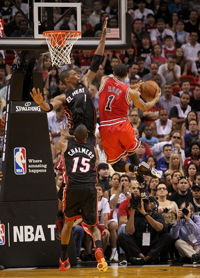 MIAMI, FL - MARCH 06:  Derrick Rose #1 of the Chicago Bulls shoots over Chris Bosh #1 of the Miami Heat during a game at American Airlines Arena on March 6, 2011 in Miami, Florida. NOTE TO USER: User expressly acknowledges and agrees that, by downloading