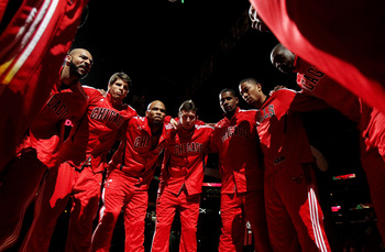 CHICAGO, IL - MARCH 25: Members of the Chicago Bulls including (L-R) Carlos Boozer #5, Kyle Korver #26, Taj Gibson #22, Omer Asik #3, Kurt Thomas #40, Derrick Rose #1, Loul Deng #9 and Keith Bogans #6 huddle before a game against the Memphis Grizzlies at