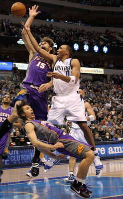 DALLAS - FEBRUARY 17:   Forward Shawn Marion #0 of the Dallas Mavericks fouls Steve Nash #13 of the Phoenix Suns on February 17, 2010 at American Airlines Center in Dallas, Texas.  NOTE TO USER: User expressly acknowledges and agrees that, by downloading