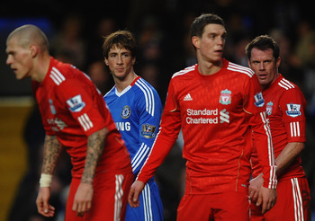 LONDON, ENGLAND - FEBRUARY 06:  Fernando Torres of Chelsea looks across a Liverpool defenders Martin Skrtel (L), Daniel Agger (2R) and Jamie Carragher )R) during the Barclays Premier League match between Chelsea and Liverpool at Stamford Bridge on Februar