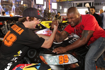 LOS ANGELES, CA - JANUARY 21:  Travis Pastrana (L) and Quinton 'Rampage' Jackson arm wrestle at the Pastrana-Waltrip Racing announcement of the 2011 NASCAR Nationwide partnership on January 21, 2011 in Los Angeles, California.  (Photo by Noel Vasquez/Gett