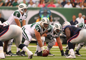 EAST RUTHERFORD, NJ - SEPTEMBER 19:  Mark Sanchez #6, Nick Mangold #74, and Matt Slauson #68 of the New York Jets prepare for the snap against the New England Patriots during their  game on September 19, 2010 at the New Meadowlands Stadium  in East Ruther