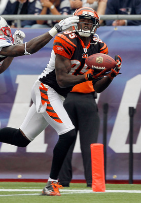 FOXBORO, MA - SEPTEMBER 12:  Darius Butler #28 of the New England Patriots cannot stop a touchdown catch by Chad Ochocinco #85 of the Cincinnati Bengals in the second half during the NFL season opener  at Gillette Stadium on September 12, 2010 in Foxboro,