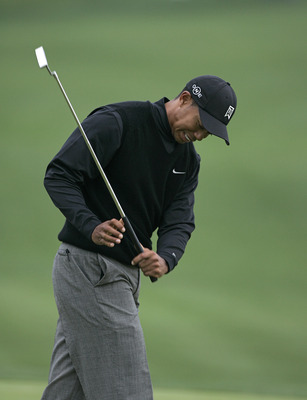 UNITED STATES - MARCH 23:  Tiger Woods reacts to a missed putt on the 18th green during the first round for THE PLAYERS Championship held at the TPC Stadium Course in Ponte Vedra Beach, Florida on March 23, 2006.  (Photo by Michael Cohen/Getty Images)