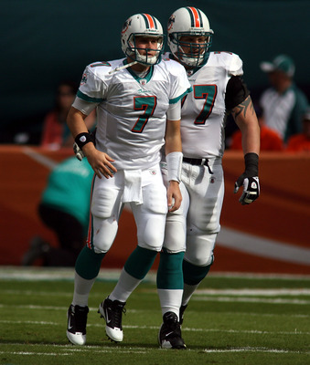MIAMI - DECEMBER 19:  Quarterback Chad Henne #7 and Lineman Jake Long#77 of the Miami Dolphins throws against the Buffalo Bills at Sun Life Stadium on December 19, 2010 in Miami, Florida. The Bills defeated the Dolphins 17-14.  (Photo by Marc Serota/Getty