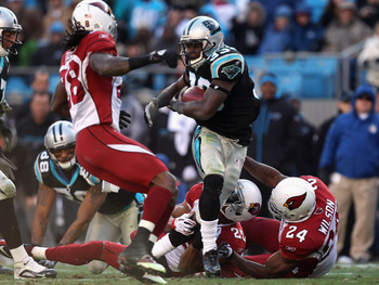 CHARLOTTE, NC - DECEMBER 19:  The defense of the Arizona Cardinals tries to stop Mike Goodson #33 of the Carolina Panthers during their game at Bank of America Stadium on December 19, 2010 in Charlotte, North Carolina.  (Photo by Streeter Lecka/Getty Imag