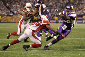 MINNEAPOLIS - NOVEMBER 07:  Running back Adrian Peterson #28 of the Minnesota Vikings carries the ball against cornerback Greg Toler #28 of the Arizona Cardinals in the fourth quarter at Hubert H. Humphrey Metrodome on November 7, 2010 in Minneapolis, Min