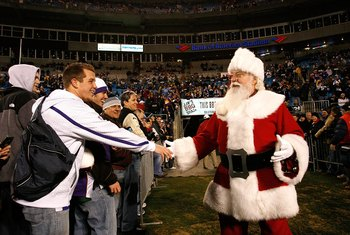 CHARLOTTE, NC - DECEMBER 20:  Santa Claus enters the stadium before the game between the Minnesota Vikings and the Carolina Panthers at Bank of America Stadium on December 20, 2009 in Charlotte, North Carolina.  (Photo by Kevin C. Cox/Getty Images)