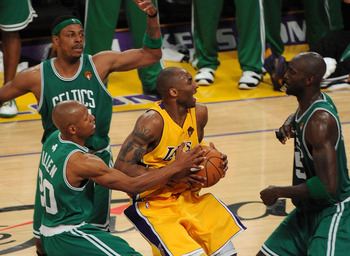 LOS ANGELES, CA - JUNE 17:  Kobe Bryant #24 of the Los Angeles Lakers drives between Ray Allen #20, Kevin Garnett #5 and Paul Pierce #34 of the Boston Celtics in the third quarter of Game Seven of the 2010 NBA Finals at Staples Center on June 17, 2010 in