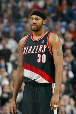 SACRAMENTO, CA - JANUARY 20:  Rasheed Wallace #30 of the Portland Trail Blazers smiles during the game against the Sacramento Kings at Arco Arena on January 20, 2004 in Sacramento, California.  The Trail Blazers won 109-104.  NOTE TO USER: User expressly