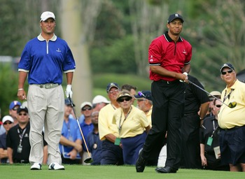 ORLANDO, FL - MARCH 26:  Tiger Woods of the USA and the Isleworth team hits his tee shot at the par 4, 1st hole watched by his opponent Chris DiMarco of the USA and the Lake Nona Team during the first day of the 2007 Tavistock Cup held at the Lake Nona Go
