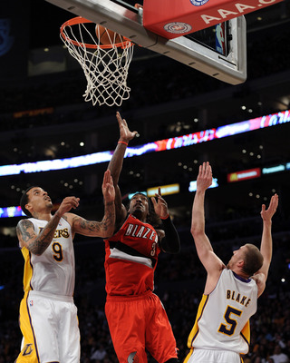 LOS ANGELES, CA - MARCH 20:  Gerald Wallace #3 of the Portland Trail Blazers scores off of a layup in front of Matt Barnes #9 and Steve Blake #5 of the Los Angeles Lakers at the Staples Center on March 20, 2011 in Los Angeles, California.  NOTE TO USER: U