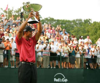 ATLANTA - SEPTEMBER 16:  Tiger Woods holds the FedEx Cup trophy after winning the TOUR Championship, the final event of the new PGA TOUR Playoffs for the FedExCup at East Lake Golf Club on September 16, 2007 in Atlanta, Georgia.  (Photo by Streeter Lecka/