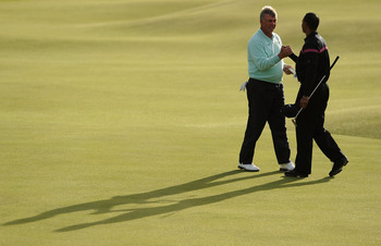 ST ANDREWS, SCOTLAND - JULY 17:  (L-R) Darren Clarke of Northern Ireland shakes hands with Tiger Woods of the USA on the 18th green during the third round of the 139th Open Championship on the Old Course, St Andrews on July 17, 2010 in St Andrews, Scotlan