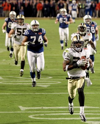 MIAMI GARDENS, FL - FEBRUARY 07:  Tracy Porter #22 of the New Orleans Saints returns a interception for a touchdown against of the Indianapolis Colts during Super Bowl XLIV on February 7, 2010 at Sun Life Stadium in Miami Gardens, Florida.  (Photo by Ezra