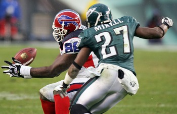 PHILADELPHIA - DECEMBER 30:  Michael Gaines #86  of the Buffalo Bills cannot hold onto a pass as he is pressured by Quintin Mikell #27 of the Philadelphia Eagles on December 30, 2007 at Lincoln Financial Field in Philadelphia, Pennsylvania. The Eagles def