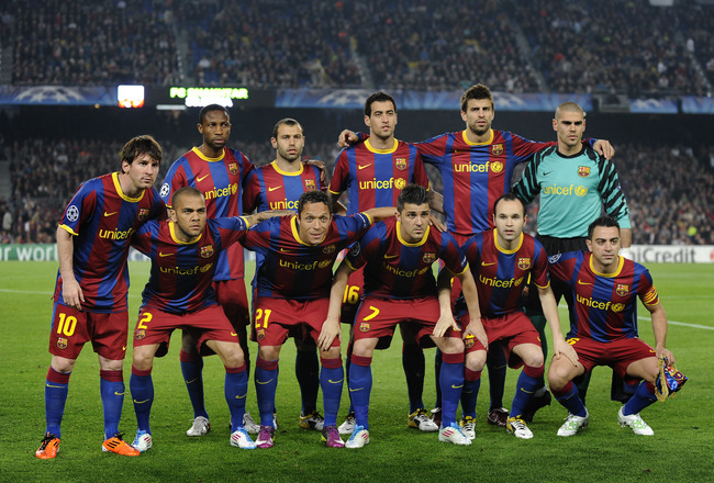 BARCELONA, SPAIN - APRIL 06: (L-R back row)) Seydou Keita, Javier Mascherano, Sergio Busquets, Gerard Pique and Victor Valdes (L-R front row) Lionel Messi, Dani Alves, Adriano, David Villa, Andres Iniesta and Xavi Hernandez of FC Barcelona pose for a team