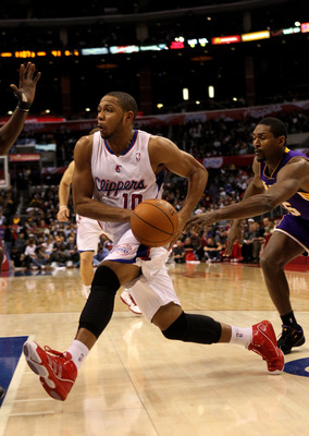 LOS ANGELES, CA - DECEMBER 08:  Eric Gordon #10 of the Los Angeles Clippers drives against the Los Angeles Lakers at Staples Center on December 8, 2010 in Los Angeles, California. The Lakers won 87-86.  NOTE TO USER: User expressly acknowledges and agrees