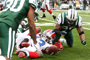 EAST RUTHERFORD, NJ - JANUARY 02:  Steve Johnson #13 of the Buffalo Bills fumbles against Dwight Lowery #26 of the New York Jets at New Meadowlands Stadium on January 2, 2011 in East Rutherford, New Jersey.  (Photo by Michael Heiman/Getty Images)