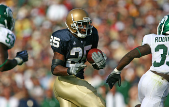SOUTH BEND, IN - SETPEMBER 19: Jonas Gray #25 of the Notre Dame Fighting Irish runs for a first down against the Michigan State Spartans on September 19, 2009 at Notre Dame Stadium in South Bend, Indiana. (Photo by Jonathan Daniel/Getty Images)