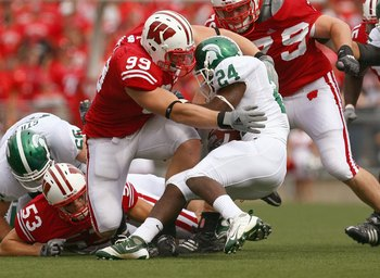 MADISON, WI - SEPTEMBER 26: J.J. Watt #99 of the Wisconsin Badgers tackles Caulton Ray #24 of the Michigan State Spartans on September 26, 2009 at Camp Randall Stadium in Madison, Wisconsin. Wisconsin defeated Michigan State 38-30. (Photo by Jonathan Dani
