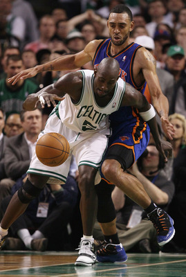 BOSTON, MA - APRIL 19:  Kevin Garnett #5 of the Boston Celtics heads for the basket around Jared Jeffries #9 of the New York Knicks  in Game Two of the Eastern Conference Quarterfinals in the 2011 NBA Playoffs on April 19, 2011 at the TD Garden in Boston,
