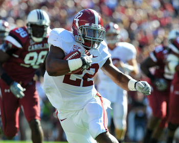 COLUMBIA, SC - OCTOBER 9: Running back Mark Ingram #22 of the Alabama Crimson Tide rushes upfield against the South Carolina Gamecocks October 9, 2010 at Williams-Brice Stadium in Columbia, South Carolina.  (Photo by Al Messerschmidt/Getty Images)
