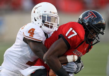 LUBBOCK, TX - SEPTEMBER 18:  Detron Lewis #17 of the Texas Tech Red Raiders makes a pass reception against Aaron Williams #4 of the Texas Longhorns at Jones AT&T Stadium on September 18, 2010 in Lubbock, Texas.  (Photo by Ronald Martinez/Getty Images)