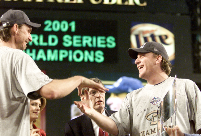 4 Nov 2001:  Co-MVP winners Curt Schilling #38 and Randy Johnson #51 of the Arizona Diamondbacks celebrate before being presented the MVP trophy by commissioner Bud Selig after winning the World Series over the New York Yankees at Bank One Ballpark in Pho