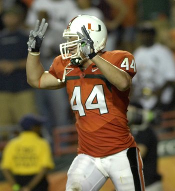 MIAMI, FL - SEPTEMBER 20: Linebacker Colin McCarthy #44 of the University of Miami  Hurricanes celebrates a defensive play against the Texas A&M Aggies at the Orange Bowl on September 20, 2007 in Miami, Florida.  Miami won 31-17.  (Photo by Al Messerschmi