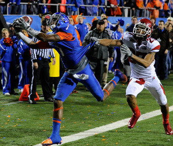 LAS VEGAS, NV - DECEMBER 22:  Titus Young #1 of the Boise State Broncos catches a pass just out of bounds in the end zone in front of Brandon Burton #27 of the Utah Utes during the MAACO Bowl Las Vegas at Sam Boyd Stadium December 22, 2010 in Las Vegas, N