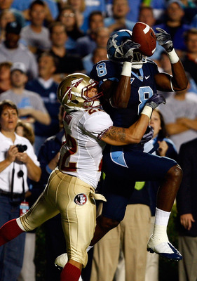 CHAPEL HILL, NC - OCTOBER 22:  Greg Little #8 of the North Carolina Tar Heels makes a catch against Florida State Seminole defender Korey Mangum #22  at Kenan Stadium on October 22, 2009 in Chapel Hill, North Carolina.  (Photo by Scott Halleran/Getty Imag