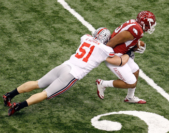 NEW ORLEANS, LA - JANUARY 04:  D.J. Williams #45 of the Arkansas Razorbacks attempts to not touch the ground as he tries to break a tackle by Ross Homan #51 of the Ohio State Buckeyes in the first half during the Allstate Sugar Bowl at the Louisiana Super
