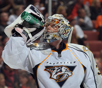 ANAHEIM, CA - APRIL 15:  Goaltender Pekka Rinne #35 of the Nashville Predators drinks during a time out against the Anaheim Ducks in Game Two of the Western Conference Quarterfinals during the 2011 NHL Stanley Cup Playoffs at Honda Center on April 15, 201