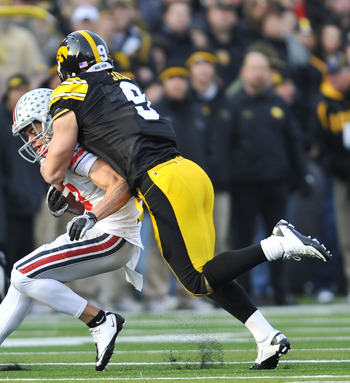 IOWA CITY, IA - NOVEMBER 20: Defensive back Tyler Sash #9 of the University of Iowa Hawkeyes tackles wide receiver Dane Sanzenbacher #12 of the Ohio State Buckeyes during the first half of play at Kinnick Stadium on November 20, 2010 in Iowa City, Iowa. O