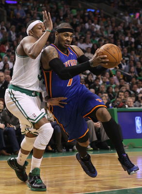 BOSTON, MA - APRIL 17:  Carmelo Anthony #7 of the New York Knicks heads for the net as Paul Pierce #34 of the Boston Celtics defends in Game One of the Eastern Conference Quarterfinals in the 2011 NBA Playoffs on April 17, 2011 at the TD Garden in Boston,