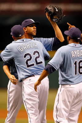 ST. PETERSBURG - APRIL 25:  Pitcher David Price is congratulated by pitcher Matt Garza #22 and infielder Willy Aybar #16 of the Tampa Bay Rays after his complete game shutout against the Toronto Blue Jays at Tropicana Field on April 25, 2010 in St. Peters