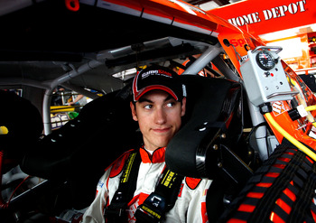 TALLADEGA, AL - APRIL 15:  Joey Logano, driver of the #20 The Home Depot Toyota, sits in the garage during practice for the NASCAR Sprint Cup Series Aaron's 499 at Talladega Superspeedway on April 15, 2011 in Talladega, Alabama.  (Photo by Jeff Zelevansky