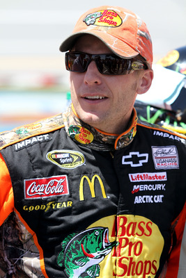 TALLADEGA, AL - APRIL 17:  Jamie McMurray, driver of the #1 Bass Pro Shops/Tracker Boats Chevrolet, stands on the grid prior to the start of the NASCAR Sprint Cup Series Aaron's 499 at Talladega Superspeedway on April 17, 2011 in Talladega, Alabama.  (Pho