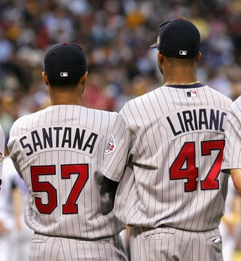 PITTSBURGH - JULY 11:  (L-R) American League All-Star Johan Santana #57 of the Minnesota Twins, Francisco Liriano #47 of the Minnesota Twins and Joe Mauer #7 of the Minnesota Twins stands  during the 77th MLB All-Star Game at PNC Park on July 11, 2006 in