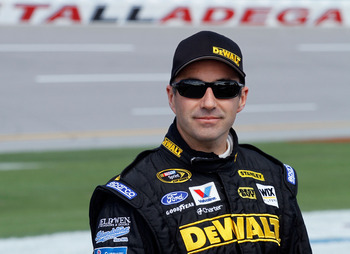 TALLADEGA, AL - APRIL 16:  Marcos Ambrose, driver of the #9 Dewalt Ford, stands on the grid during qualifying for the NASCAR Sprint Cup Series Aaron's 499 at Talladega Superspeedway on April 16, 2011 in Talladega, Alabama.  (Photo by Jason Smith/Getty Ima