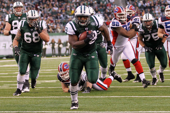 EAST RUTHERFORD, NJ - JANUARY 02:  John Conner #38 of the New York Jets runs for a touchdown against the Buffalo Bills at New Meadowlands Stadium on January 2, 2011 in East Rutherford, New Jersey.  (Photo by Al Bello/Getty Images)