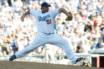LOS ANGELES, CA - OCTOBER 16:  Jonathan Broxton #51 of the Los Angeles Dodgers pitches against the Philadelphia Phillies during Game Two of the NLCS during the 2009 MLB Playoffs at Dodger Stadium on October 16, 2009 in Los Angeles, California.  (Photo by