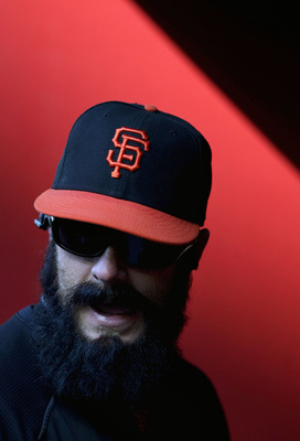 PHOENIX, AZ - APRIL 16:  Relief pitcher Brian Wilson #38 of the San Francisco Giants walks in the dugout before the Major League Baseball game against the Arizona Diamondbacks at Chase Field on April 16, 2011 in Phoenix, Arizona.  (Photo by Christian Pete