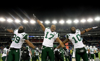 FOXBORO, MA - JANUARY 16:  Jerricho Cotchery #89, Braylon Edwards #17 and Santonio Holmes #10 of the New York Jets celebrate their 28 to 21 victory over the New England Patriots during their 2011 AFC divisional playoff game at Gillette Stadium on January
