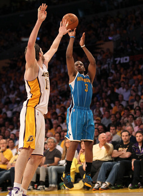 LOS ANGELES, CA - APRIL 17:  Chris Paul #3 of  the New Orleans Hornets makes a jump shot over Pau Gasol #16 of the Los Angeles Lakers in Game One of the Western Conference Quarterfinals in the 2011 NBA Playoffs on April 17, 2011 at Staples Center in Los A