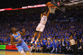 OKLAHOMA CITY, OK - APRIL 17: Russell Westbrook #0 of the Oklahoma City Thunder dunks the ball against Raymond Felton #20 of the Denver Nuggets in Game One of the Western Conference Quarterfinals in the 2011 NBA Playoffs on April 17, 2011 at the Ford Cent