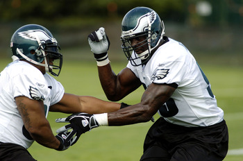 BETHLEHEM, PA - JULY 31:  Jevon Kearse #93 and Jerome McDougle #95 of the Philadelphia Eagles practice a blocking drill during training camp on July 31, 2004 at Lehigh University in Bethlehem, Pennsylvania.  (Photo by Greg Fiume/Getty Images)
