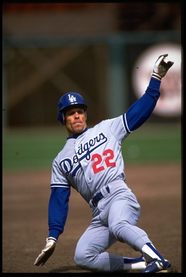 1992:  LOS ANGELES DODGERS CENTER FIELDER Brett BUTLER SLIDES INTO THIRD BASE DURING THE DODGERS VERSUS SAN FRANCISCO GIANTS GAME AT SAN FRANCISCO, CALIFORNIA.