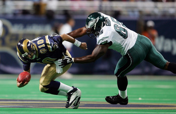 ST.LOUIS - DECEMBER 27:  Quarterback Marc Bulger #10 of the St. Louis Rams is sacked by Jamaal Green #65 of the Philadelphia Eagles on December 27, 2004 at the Edward Jones Dome in St. Louis, Missouri.  (Photo by Elsa/Getty Images)